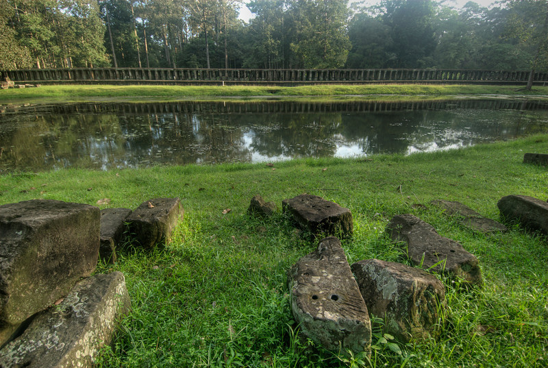 Closer look of pond with moss covered rocks in Angkor Wat