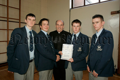 St Colmans College Junior prizegiving. Eamon Lynch recieves the PE award from Dr Francis Brown. Also in picture are school Prefects, Edward O'Hare, Michael Mulvanny and Gary Buchanan.