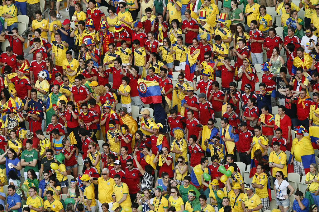 . Colombia\'s fans cheer during the quarter-final football match between Brazil and Colombia at the Castelao Stadium in Fortaleza during the 2014 FIFA World Cup on July 4, 2014. FABRIZIO BENSCH/AFP/Getty Images