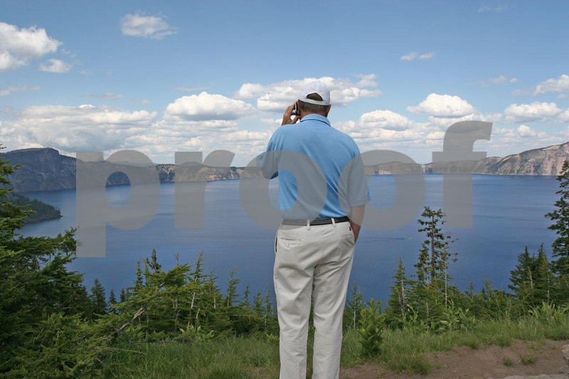 """Americans are addicted to their cell phones and when vacationing at Crater Lake National Park, the highest priority is to call someone and say, """"Guess where I am?"""" OR"""