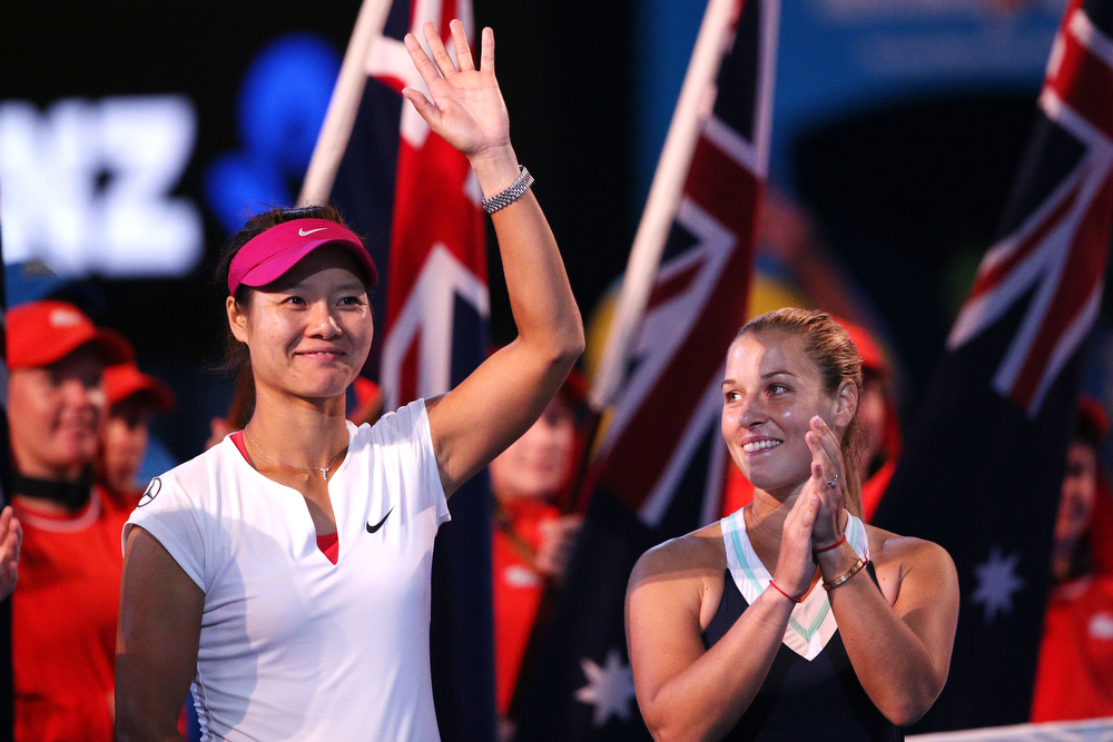 . Na Li (L) of China and Dominika Cibulkova of Slovakia watch the presentation after their women\'s final match during day 13 of the 2014 Australian Open at Melbourne Park on January 25, 2014 in Melbourne, Australia.  (Photo by Clive Brunskill/Getty Images)