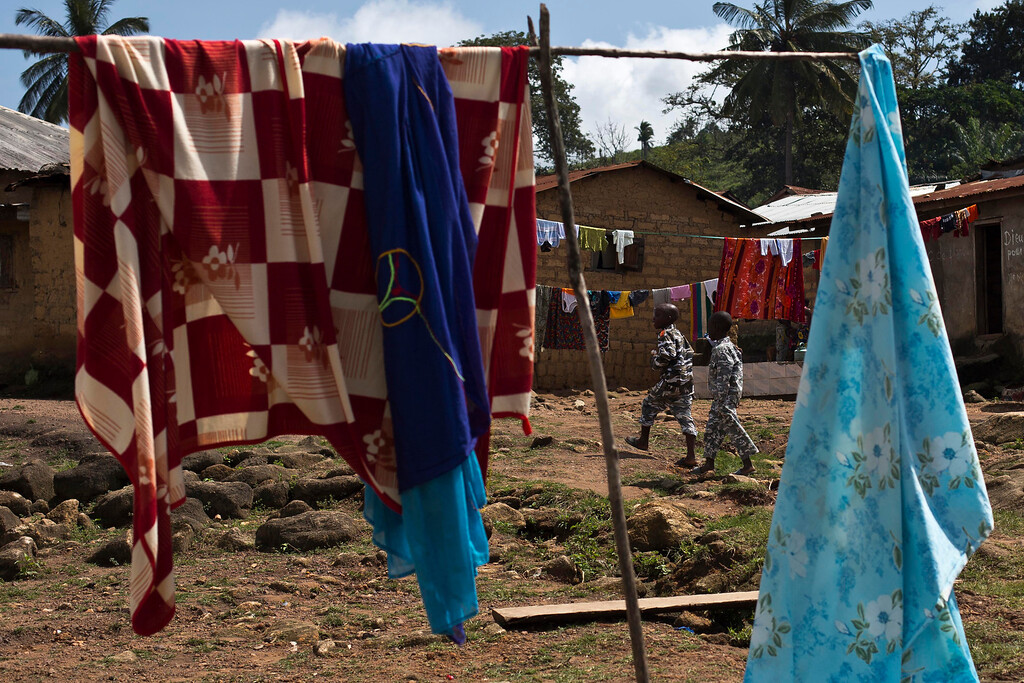 . In this photo taken Thursday, Nov. 20, 2014, laundry dries in the Guinean village of Meliandou, some 400 miles (600 mms) south-east of Conakry, Guinea, believed to be Ebola\'s ground zero. (AP Photo/Jerome Delay)