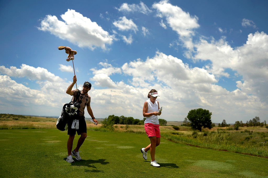 . Gwladys Nocera of France leaves the tee after her drive as she practices with the 2013 European Solheim Cup Team  on Monday, July 01, 2013, in Parker, Colorado. (Photo By Joe Amon/The Denver Post)