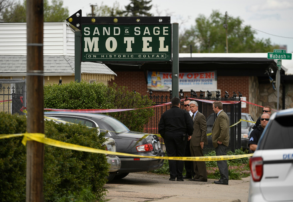 . DENVER, CO - MAY 9:  Denver police officers investigate the scene of an officer involved shooting at Colfax ave between Wabash and Verbena streets on May 9, 2016 in Denver, Colorado. One person was transported to an area hospital in critical condition. (Photo by Helen H. Richardson/The Denver Post)