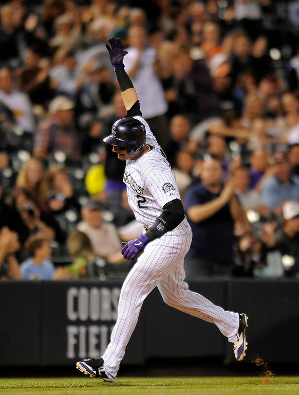 . Colorado Rockies Troy Tulowitzki celebrates as he rounds the bases after hitting a solo home run in the sixth inning of a baseball game against the Arizona Diamondbacks on Thursday, June 5, 2014, in Denver. (AP Photo/Chris Schneider)