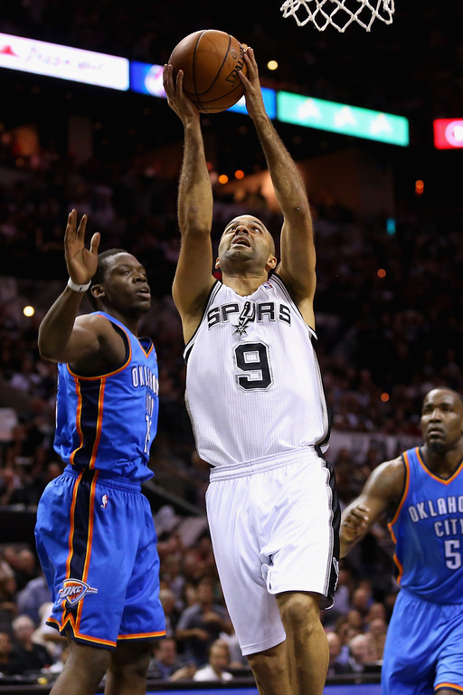. Tony Parker #9 of the San Antonio Spurs drives to the basket against Reggie Jackson #15 of the Oklahoma City Thunder in the first quarter during Game Five of the Western Conference Finals of the 2014 NBA Playoffs at AT&T Center on May 29, 2014 in San Antonio, Texas.   (Photo by Ronald Martinez/Getty Images)