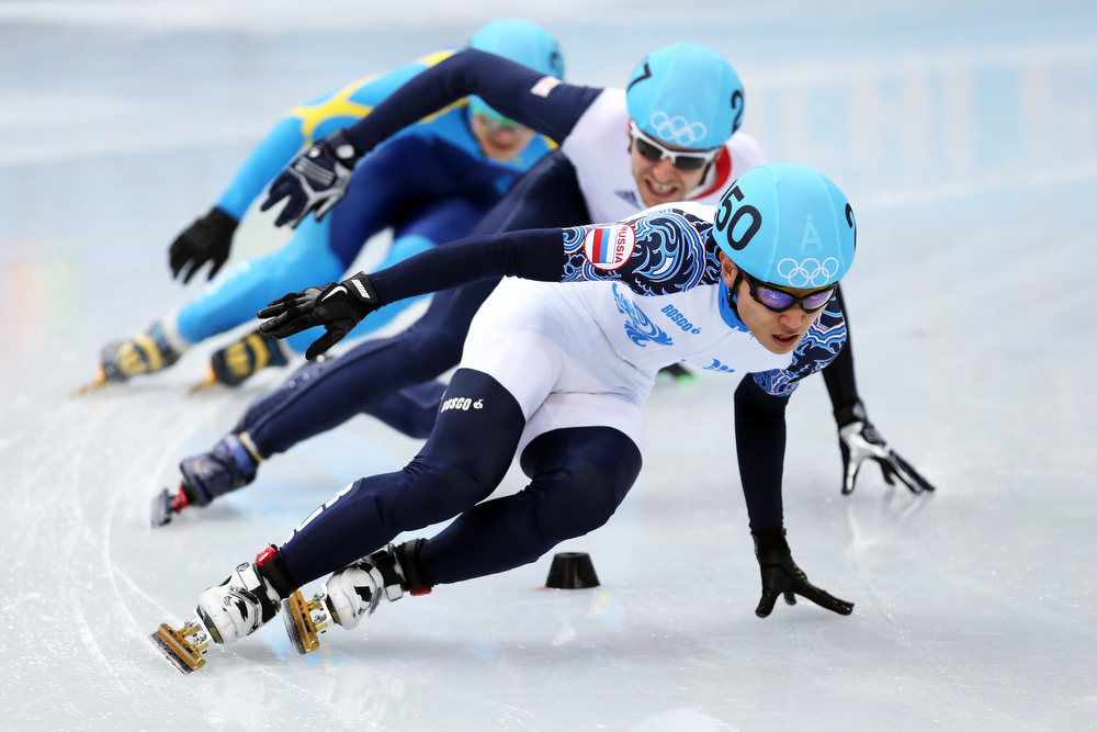 . Victor An of Russia leads the pack in the Short Track Men\'s 500m Heat at Iceberg Skating Palace on day 11 of the 2014 Sochi Winter Olympics on February 18, 2014 in Sochi, Russia.  (Photo by Matthew Stockman/Getty Images)