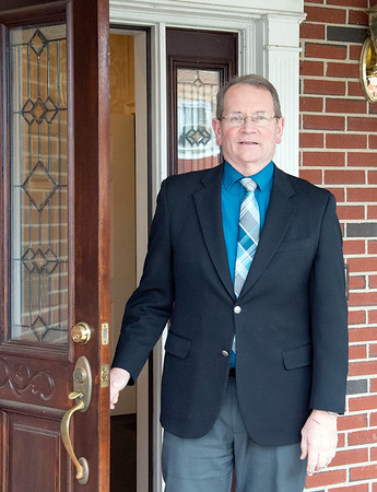 03/19/20 Wesley Bunnell | Staff Peter Hansen from Erickson-Hansen Funeral Home located at 411 S. Main St in New Britain stands by the front door on Thursday March 19, 2020.