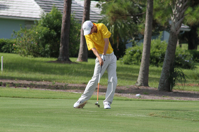 Austin Connelly takes his hybrid for a ride on the 463 yard par 4 3rd hole at the Country Club of Florida.