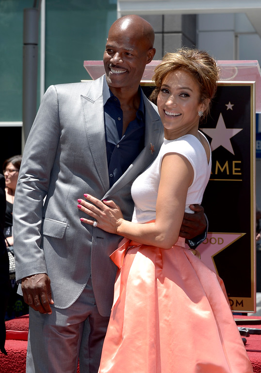 . US actress, singer Jennifer Lopez (R) and US actor Keenan Ivory Wayans (L) embrace during Lopez\' star ceremony on the Hollywood Walk of Fame in Hollywood, California, USA 20 June 2013. Lopez was awarded the 2,500th star on the Hollywood Walk of Fame in the category of Recording.  EPA/PAUL BUCK