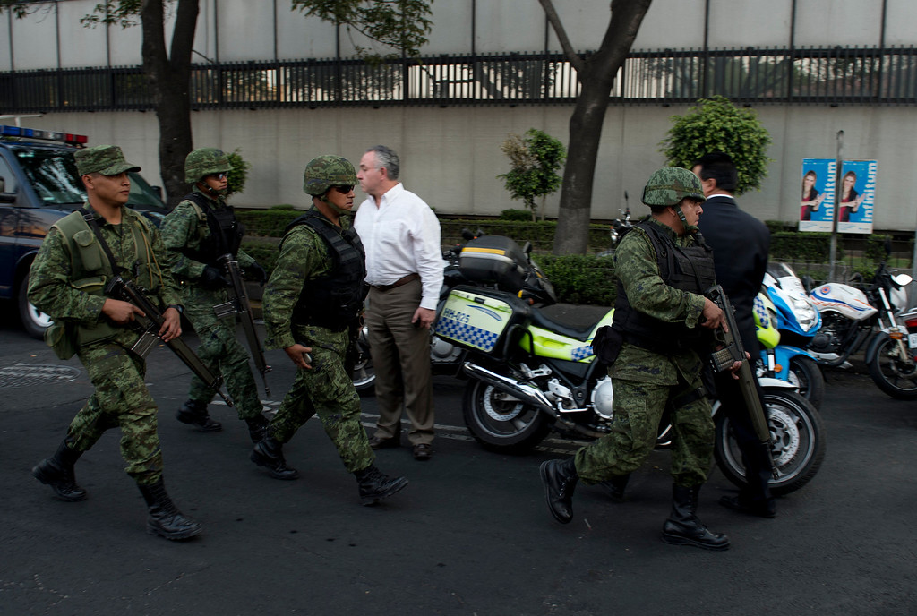 . Soldiers arrive on the premises of the skyscraper that houses the headquarters of state-owned Mexican oil giant Pemex in Mexico City on January 31, 2013, following a blast inside the building.   YURI CORTEZ/AFP/Getty Images
