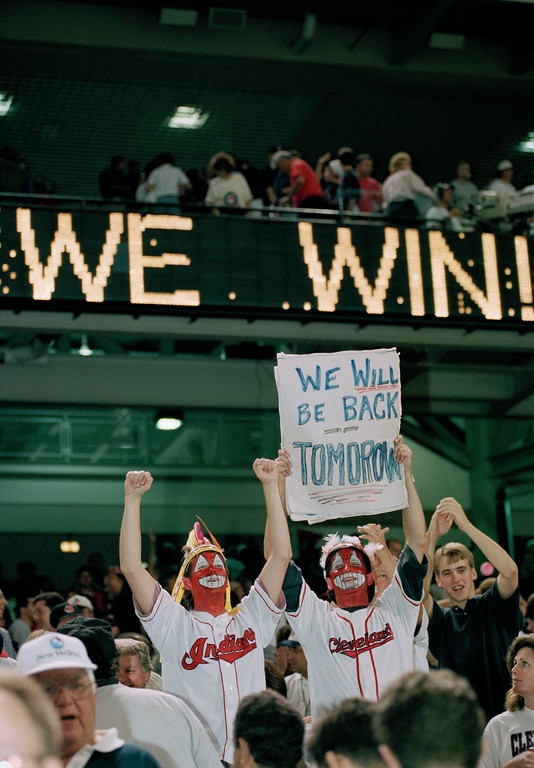 ". The ""Wahoo Brothers,\"" Tim, left, and Ed Weinfurtmer, show their support for the Cleveland Indians during their division series game against the New York Yankees in Cleveland, Ohio, Oct. 5, 1997. (AP Photo/Mark Duncan)"