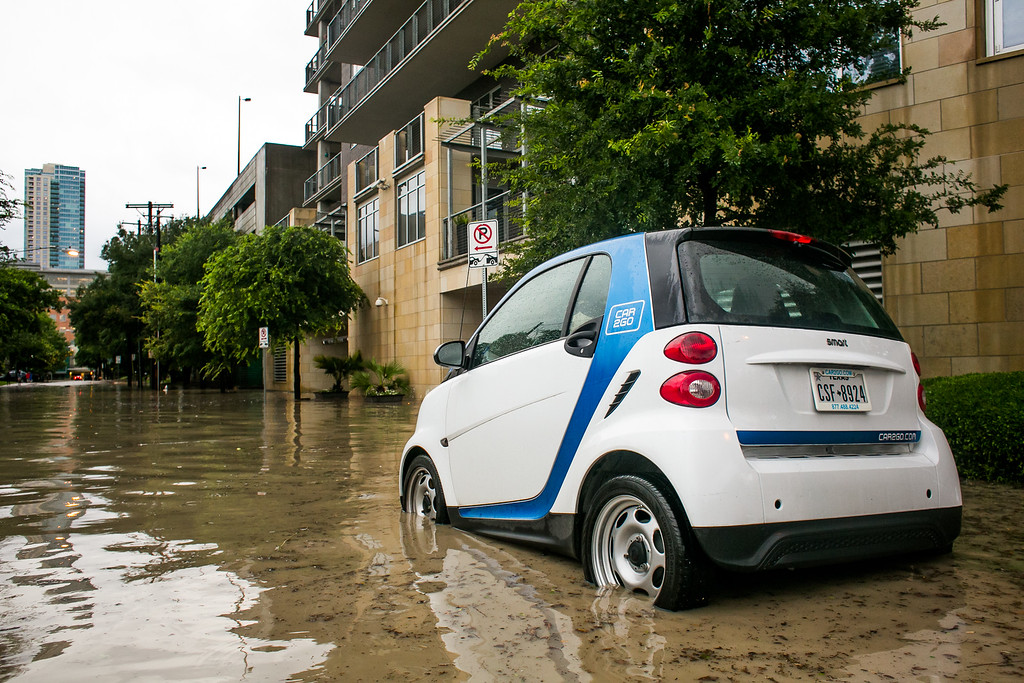 . AUSTIN, TX - MAY 25:   A Car2Go sits partially submerged in the flood zone after days of heavy rain on May 25, 2015 in Austin, Texas. Texas Gov. Greg Abbott toured the damage zone where one person is confirmed dead and at least 12 others missing in flooding along the Rio Blanco, which reports say rose as much as 40 feet in places, caused by more than 10 inches of rain over a four-day period. The governor earlier declared a state of emergency in 24 Texas counties.  (Photo by Drew Anthony Smith/Getty Images)
