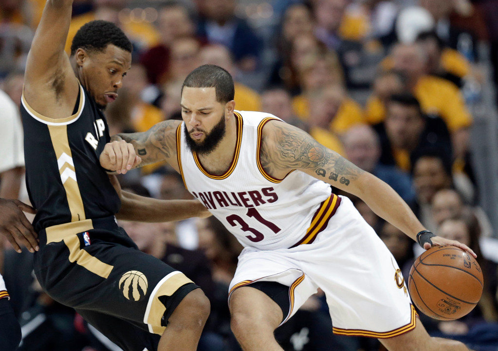 . Cleveland Cavaliers\' Deron Williams (31) fouls Toronto Raptors\' Kyle Lowry (7) during the first half in Game 2 of a second-round NBA basketball playoff series, Wednesday, May 3, 2017, in Cleveland. (AP Photo/Tony Dejak)