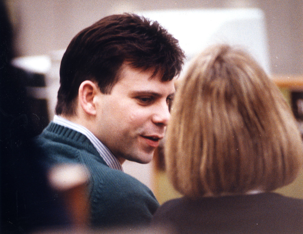 . Lyle Menendez leans over to talk to his attorney, Jill Lansing on January 13, 1994.  On August 20, 1989, Lyle and Erik Menendez murdered their parents, Jose and Kitty, in the den of the family\'s home in Beverly Hills, CA.    (L.A. Daily News file photo)