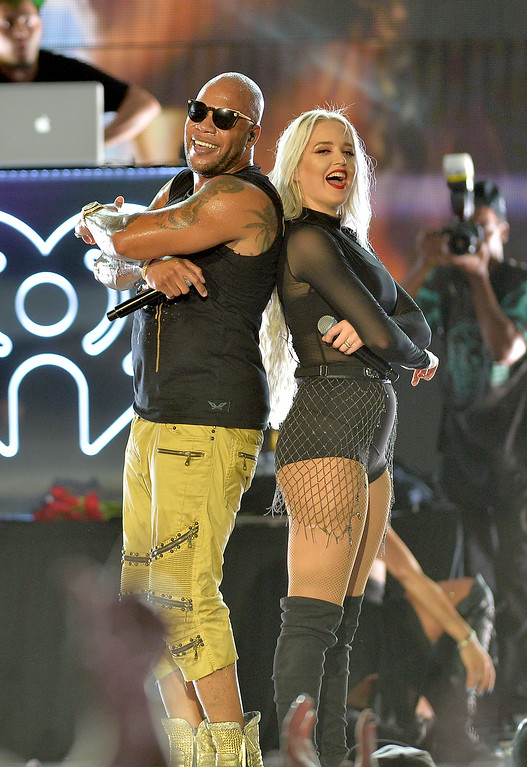 . Flo Rida and Macy Kate perform on stage during 2016 iHeartRadio Summer Pool Party at Fountainbleau Miami Beach on May 21, 2016 in Miami Beach, Florida.  (Photo by Jason Koerner/Getty Images for iHeartMedia)