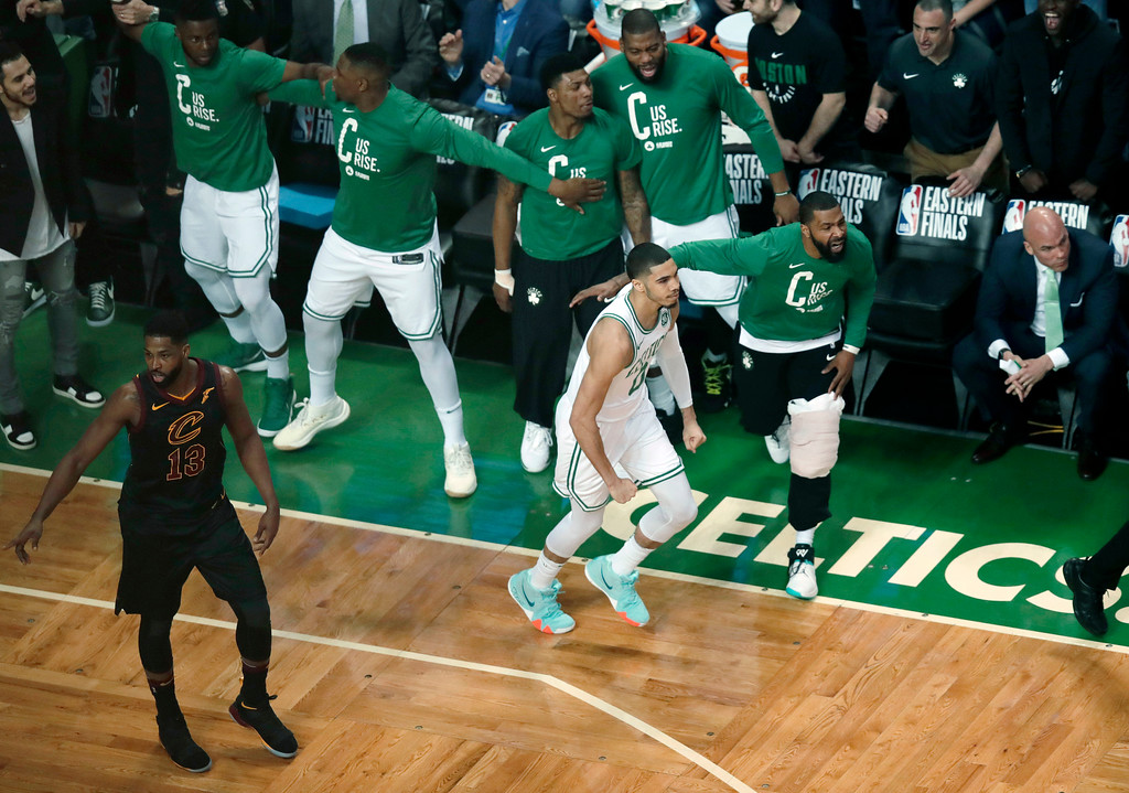 . Teammates cheer Boston Celtics forward Jayson Tatum (0) after a basket against the Cleveland Cavaliers during the first half in Game 7 of the NBA basketball Eastern Conference finals, Sunday, May 27, 2018, in Boston. At left is Cleveland Cavaliers center Tristan Thompson.(AP Photo/Charles Krupa)