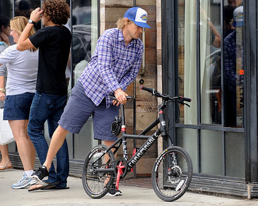 EXC: Owen Wilson Hops On His Bicycle