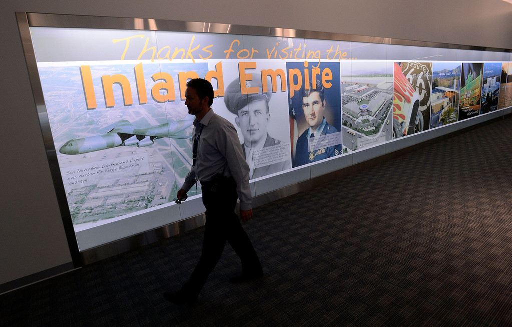 . Airport Manager Scott Gibbs walks past a display of Inland Empire history at the San Bernardino International Airport March 28, 2013.  Built on the former the site of the former Norton Air Force Base, is often described by local officials as one of the East Valley\'s best hopes for economic growth. Norton closed in 1994.  GABRIEL LUIS ACOSTA/STAFF PHOTOGRAPHER.