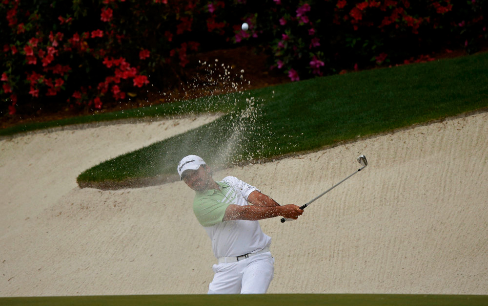 . Jason Day of Australia hits from a sand trap on the 13th green during final round play in the 2013 Masters golf tournament at the Augusta National Golf Club in Augusta, Georgia, April 14, 2013.  REUTERS/Mike Segar