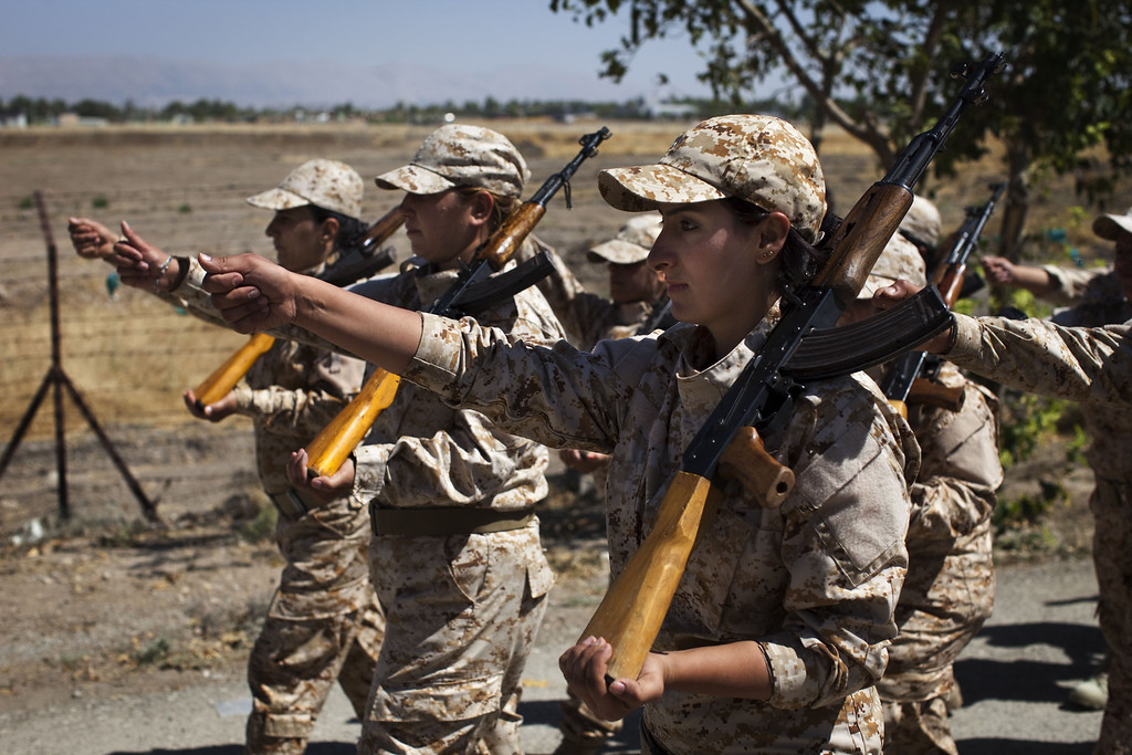 . Women Peshmerga recruits, some of whom are volunteers, parade as they take part in a military training at a base near the northern Iraqi city of Sulaimaniya on September 10, 2014. Arab nations are rallying behind US efforts to form a broad coalition against jihadists in Iraq and Syria as Kurdish and Iraqi forces continue to fight Islamic State (IS) militants. AFP PHOTO / JM LOPEZJM LOPEZ/AFP/Getty Images