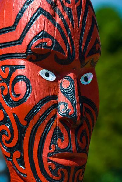 A carved moari face in Rotorua