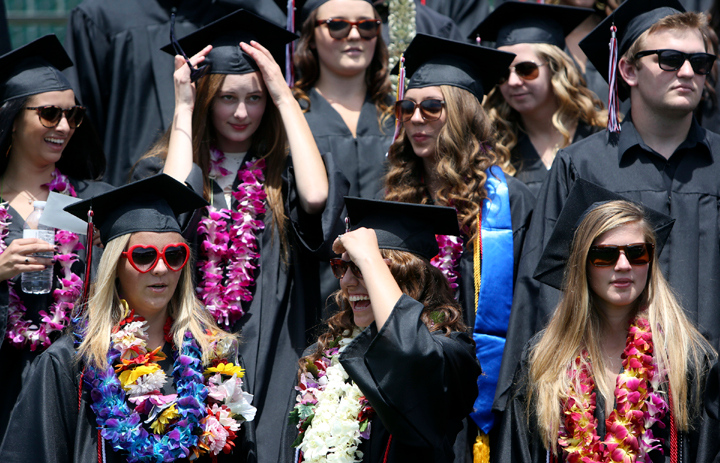 . San Lorenzo Valley High graduating seniors wait to walk across the stage at SLV High in Felton on Friday afternoon during the 2013 graduation ceremony. (Kevin Johnson/Sentinel)