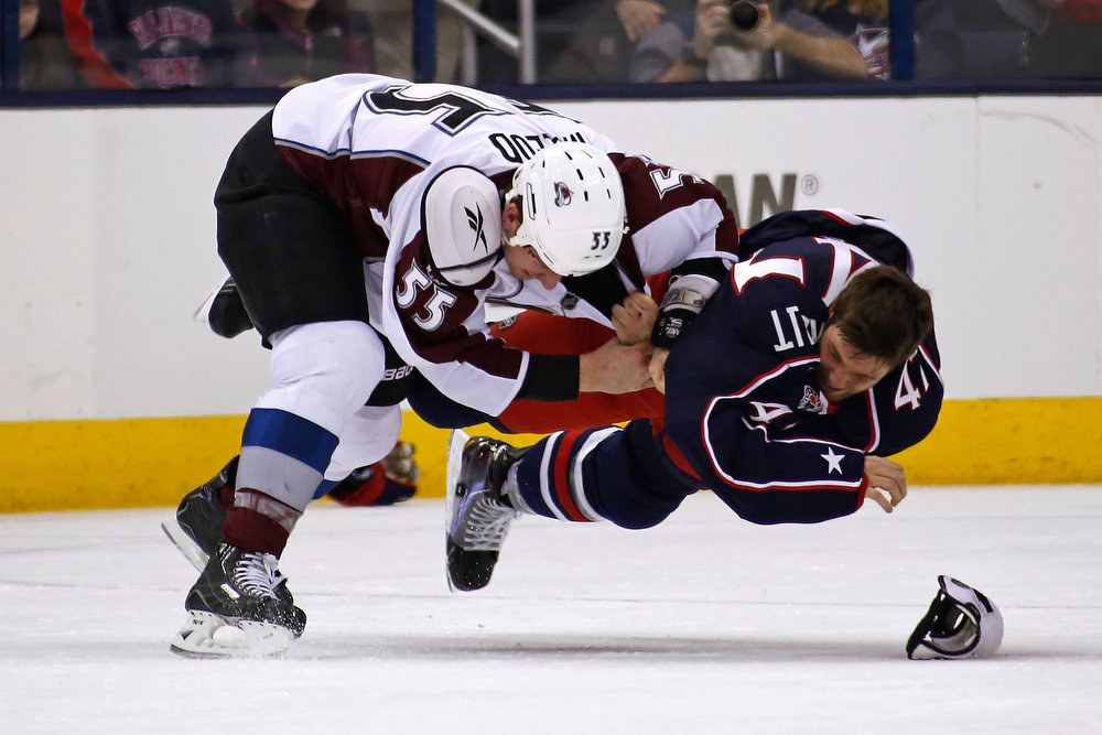. Cody McLeod #55 of the Colorado Avalanche and Dalton Prout #47 of the Columbus Blue Jackets fall to the ice during a fight in the second period on March 3, 2013 at Nationwide Arena in Columbus, Ohio. (Photo by Kirk Irwin/Getty Images)