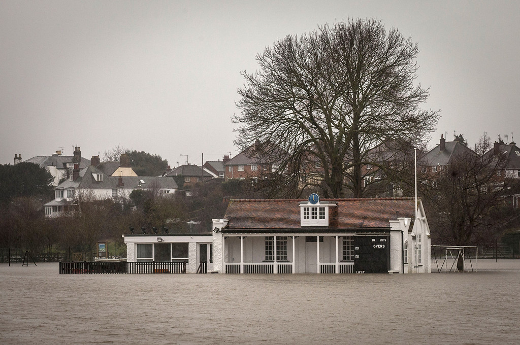 . Floodwater surrounds the cricket pavilion on The King\'s School sports field close to the banks of the River Severn on February 11, 2014 in Worcester, England. The Environment Agency has issued flood warnings for dozens of areas along the River Severn as forecasters predict more rain to come. (Photo by Rob Stothard/Getty Images)