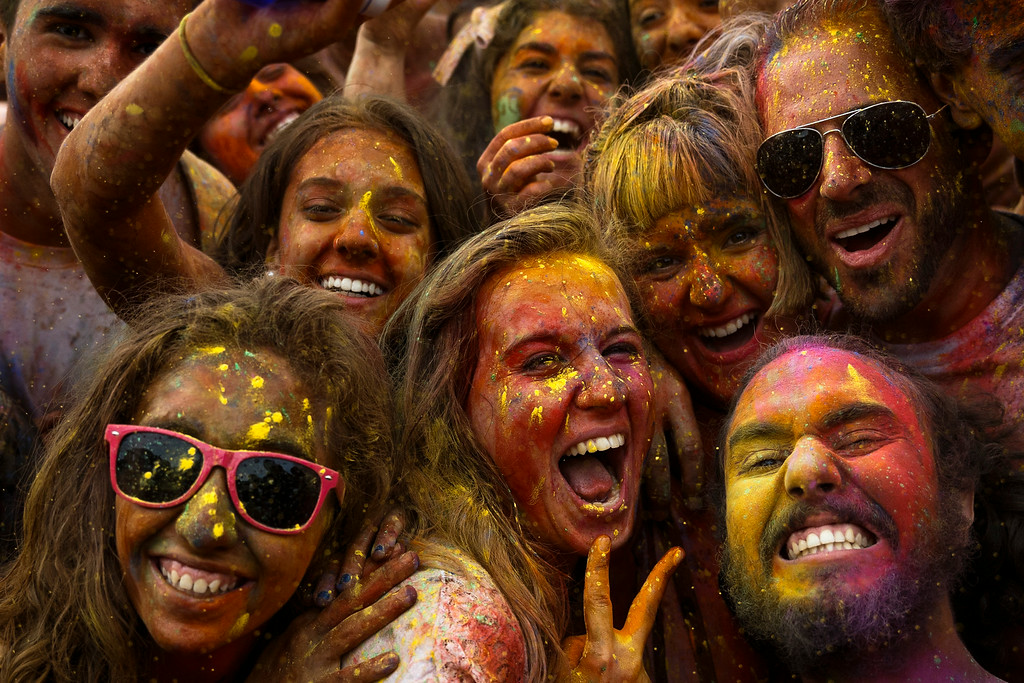 . Revelers of the Holi Festival of Colors pose for a selfie,  covered in colored powder,  in Madrid, Spain, Saturday, Aug. 9, 2014. (AP Photo/Daniel Ochoa de Olza)