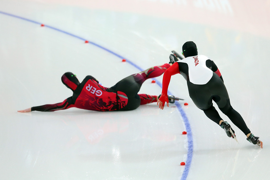 . Monique Angermueller (L) of Germany slips on the way of Kaylin Irvine of Canada during the Women\'s 1000m Speed Skating event on day 6 of the Sochi 2014 Winter Olympics at Adler Arena Skating Center on February 13, 2014 in Sochi, Russia.  (Photo by Quinn Rooney/Getty Images)