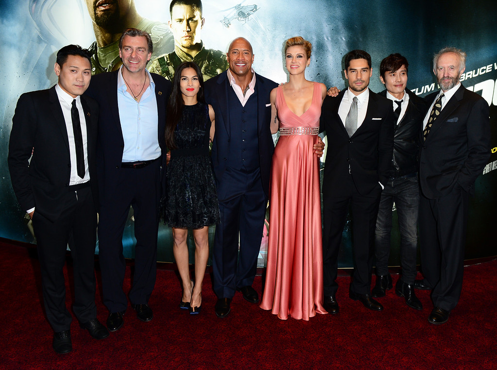 """. From left, Jon M.Chu, Ray Stevenson, Elodie Yung, Dwayne Johnson, Adrianne Palicki, D.J. Cotrona, Byung Hun-Lee and Jonathan Pryce arrive for the premiere of \""""G.I. Joe: Retaliation\"""" at a cinema Leicester Square in London, Monday, March 18, 2013. (Photo by Jon Furniss/Invision/AP)"""