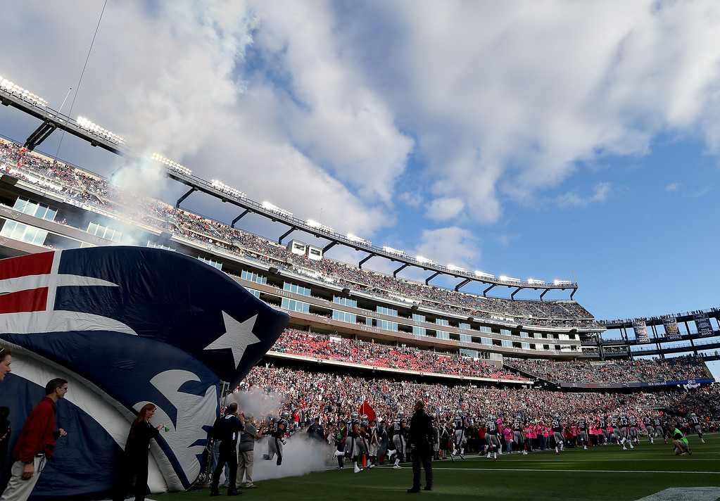 . The New England Patriots run out on the field before the game against the New Orleans Saints at Gillette Stadium on October 13, 2013 in Foxboro, Massachusetts.  (Photo by Elsa/Getty Images)