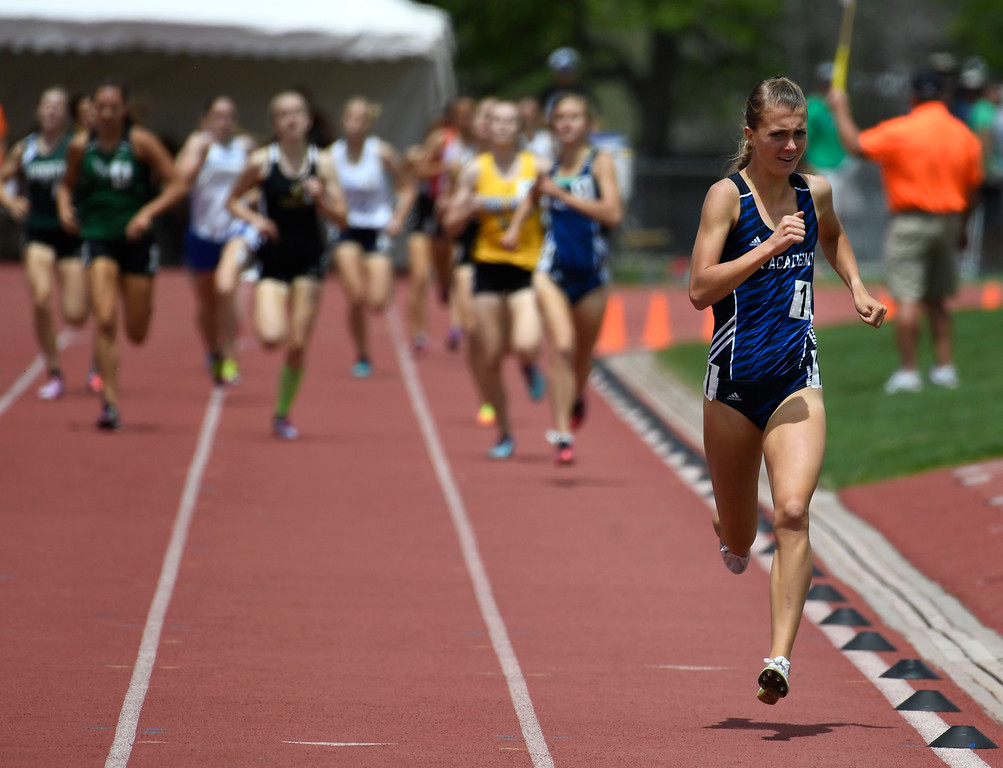 . LAKEWOOD, CO - May 20: The rest of the pack tries to catch up to Katie Rainsberger, Air Academy, right, makes her way down track during the girls 4A 800 meter run final at the Colorado State High School Track and Field Championships at Jeffco Stadium May 20, 2016. Rainsberger won the event with a time of 2:09.97 (Photo by Andy Cross/The Denver Post)