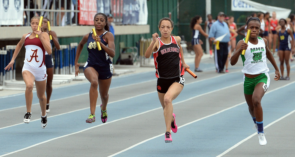 . Monrovia\'s Sydney Mosley, right, runs the last leg along with Harvard Westlake\'s Shea Copeland, Notre Dame\'s Fendi Asemota and Alemany\'s Sanchez-Guzman during the 4x100 meter relay Division 3 as Monrovia wins the race during the CIF Southern Section track and final Championships at Cerritos College in Norwalk, Calif., on Saturday, May 24, 2014.   (Keith Birmingham/Pasadena Star-News)