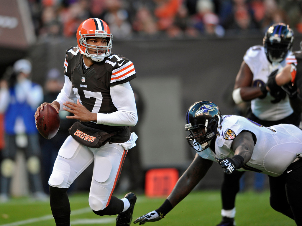. Cleveland Browns quarterback Jason Campbell (17) scrambles before being sacked by the Baltimore Ravens in the first quarter of an NFL football game Sunday, Nov. 3, 2013. (AP Photo/David Richard)
