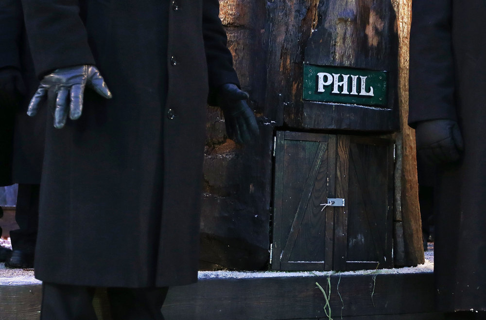. A groundhog handler waits for bringing the Punxsutawney Phil out from his winter den during the 127th Groundhog Day Celebration at Gobbler\'s Knob on February 2, 2013 in Punxsutawney, Pennsylvania. The Punxsutawney \'Inner Circle\' claimed that there were about 35,000 people gathered at the event to watch Phil\'s annual forecast.  (Photo by Alex Wong/Getty Images)