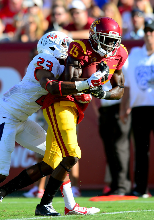. USC WR Nelson Agholor hauls in a first-quarter touchdown pass as Fresno State\'s Bryan Harper hangs on, Saturday, August 30, 2014, at the L.A. Memorial Coliseum. (Photo by Michael Owen Baker/Los Angeles Daily News)