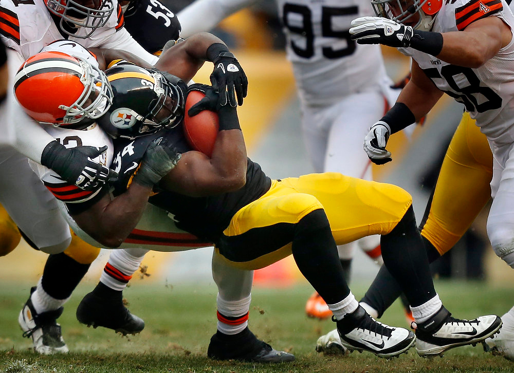 Description of . Pittsburgh Steelers running back Rashard Mendenhall (34) is tackled by the Cleveland Browns defense in the first quarter of an NFL football game in Pittsburgh, Sunday, Dec. 30, 2012. The Steelers won 24-10. (AP Photo/Gene J. Puskar)
