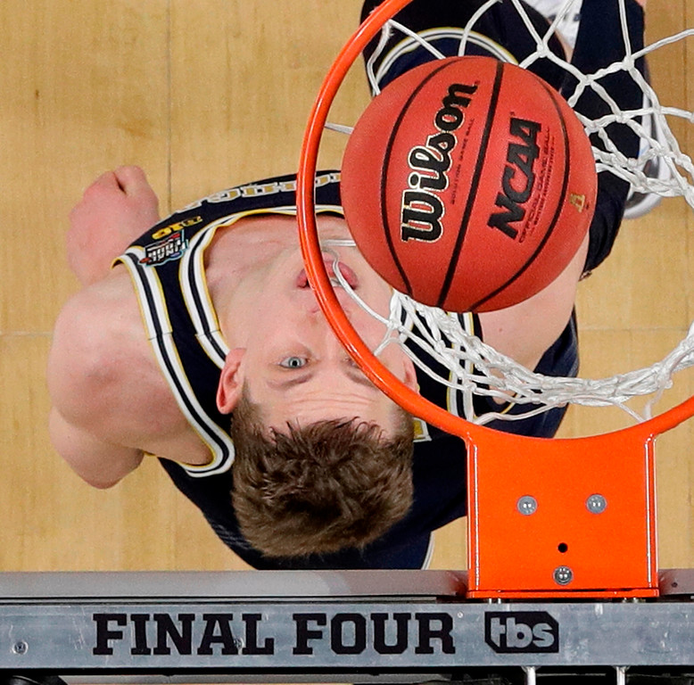 . Michigan forward Moritz Wagner watches the ball go through the basket during the first half against Villanova in the championship game of the Final Four NCAA college basketball tournament, Monday, April 2, 2018, in San Antonio. (AP Photo/David J. Phillip)