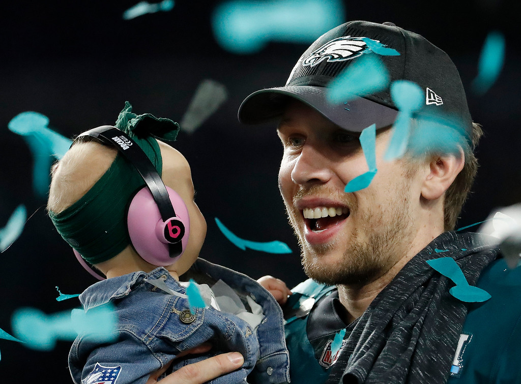 . Philadelphia Eagles\' Nick Foles holds his daughter, Lily, after the NFL Super Bowl 52 football game against the New England Patriots, Sunday, Feb. 4, 2018, in Minneapolis. The Eagles won 41-33. (AP Photo/Matt York)