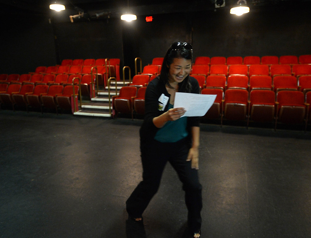 . Leadership Long Beach conducted a scavenger hunt modeled after the Amazing Race for its Class of 2014 Monday, starting at Rancho Los Alamitos. Members received points for visiting, and sometimes having to complete a task, at various landmarks in Long Beach.  Natalie Chan performs a monologue from Romeo and Juliet at the Long Beach Playhouse to get her team points. 20130826 Photo by Steve McCrank / Staff Photographer