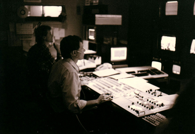 "KERA TV13 CONTROL ROOM Due to my diligence as a talent coordinator, I was later asked if I would be interested in working in the control room, as the woman who ran the teleprompter was needed for other things. ""Absolutely!!!"" I said. Here we see the director busy at work during a pledge break."