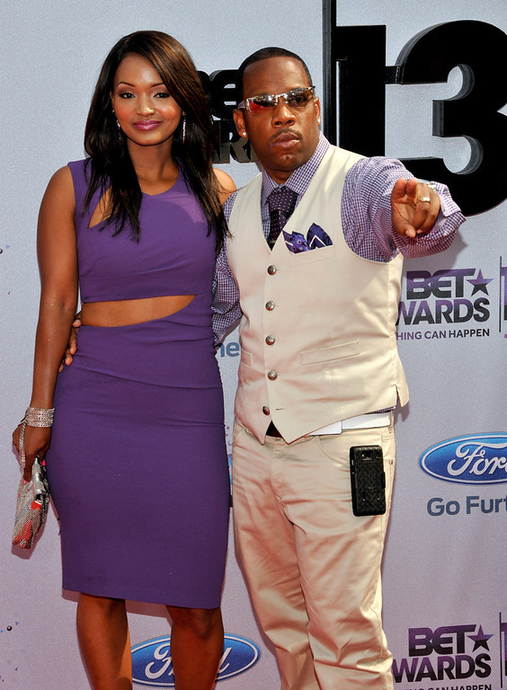 . Bobby Brown, right, arrives at the BET Awards at the Nokia Theatre on Sunday, June 30, 2013, in Los Angeles. (Photo by Chris Pizzello/Invision/AP)