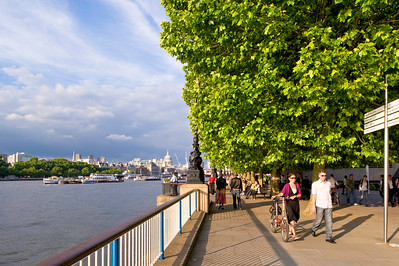 People enjoy warm summer day, Queens Walk, Southbank, London, United Kingdom