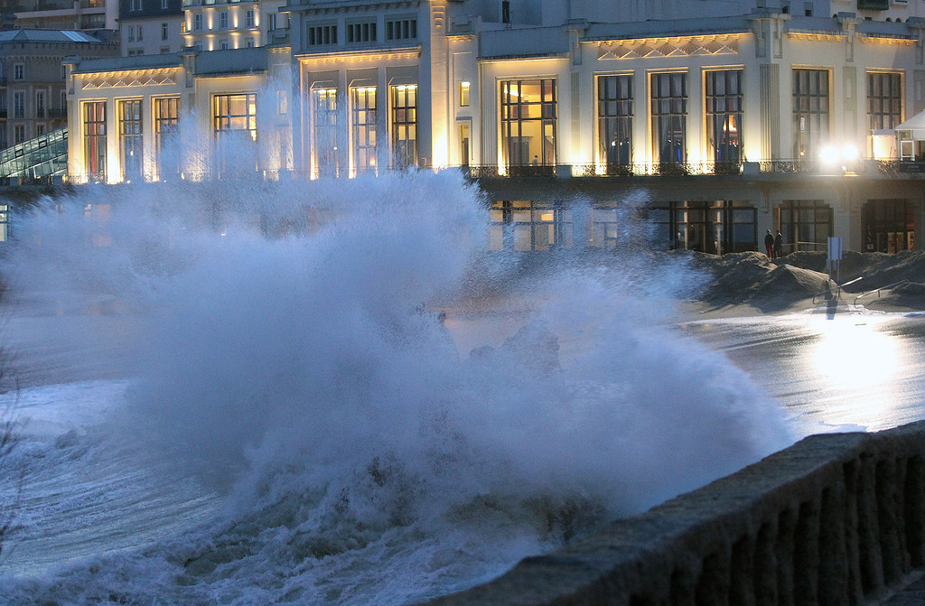 . Waves crash on the beach front, outside the Biarritz casino, in southwestern France, Tuesday, Jan. 7, 2014. There has been a weather alert for high waves in the south west of France since Monday. (AP Photo/Bob Edme)