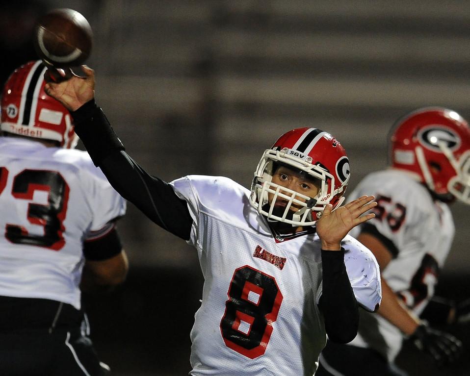 . Gladstone quarterback Juan Aldana (C) passes against Duarte in the first half of a prep football game at Duarte High School in Duarte, Calif., Thursday, Oct. 10, 2013.    (Keith Birmingham Pasadena Star-News)