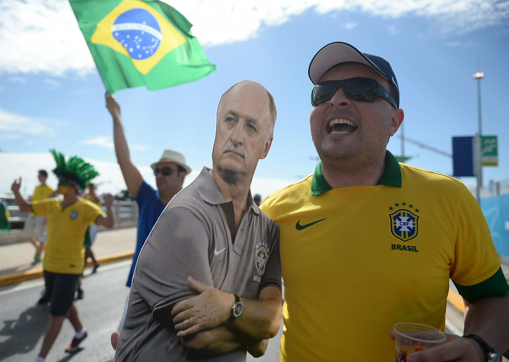 . A Brazilian supporter holds a board depecting Brazil\'s coach Luiz Felipe Scolari outside the Castelao Stadium in Fortaleza before a quarter-final football match between Brazil and Colombia during the 2014 FIFA World Cup on July 4, 2014. EITAN ABRAMOVICH/AFP/Getty Images