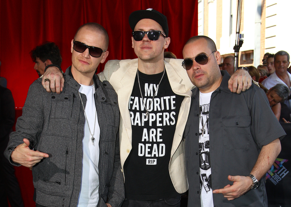 Description of . The Hilltop Hoods members, from left, Daniel Smith, Matt Lambert and Barry Francis, pose for photographers upon arrival for the Australian music industry Aria Awards in Sydney, Thursday, Nov. 29, 2012. (AP Photo/Rick Rycroft)