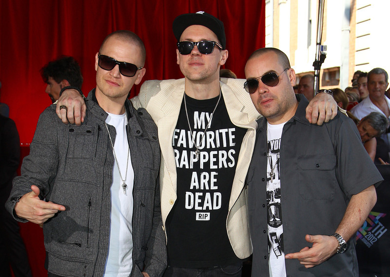 . The Hilltop Hoods members, from left, Daniel Smith, Matt Lambert and Barry Francis, pose for photographers upon arrival for the Australian music industry Aria Awards in Sydney, Thursday, Nov. 29, 2012. (AP Photo/Rick Rycroft)
